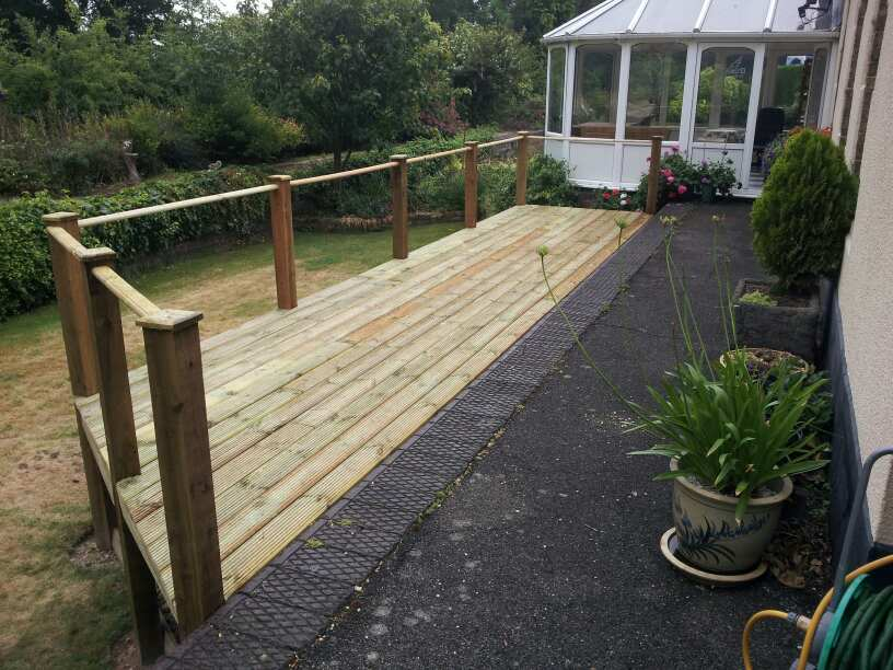 Fencing decking linnell carpentry and kitchens for Garden decking quotes uk