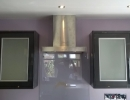 dark kitchen units and chrome extractor