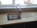 wooden sink unit in custom fitted kitchen